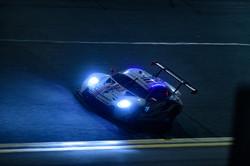 Porsche on track at night_
