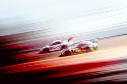 Porsche racing another car.