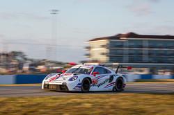 Porsche taking off on a turn.