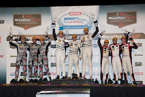 WeatherTech Racing Team on the podium.