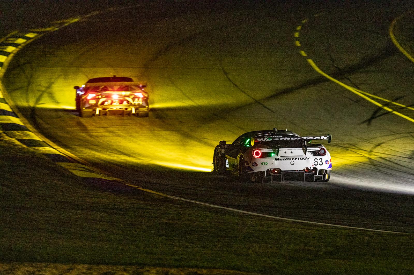 Ferrari rounding a turn in traffic.