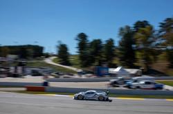 Car racing on track.