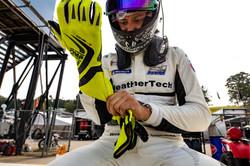 Cooper putting on glove.
