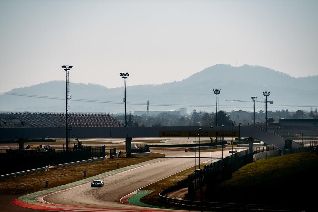 Ferrari racing the track during practice.
