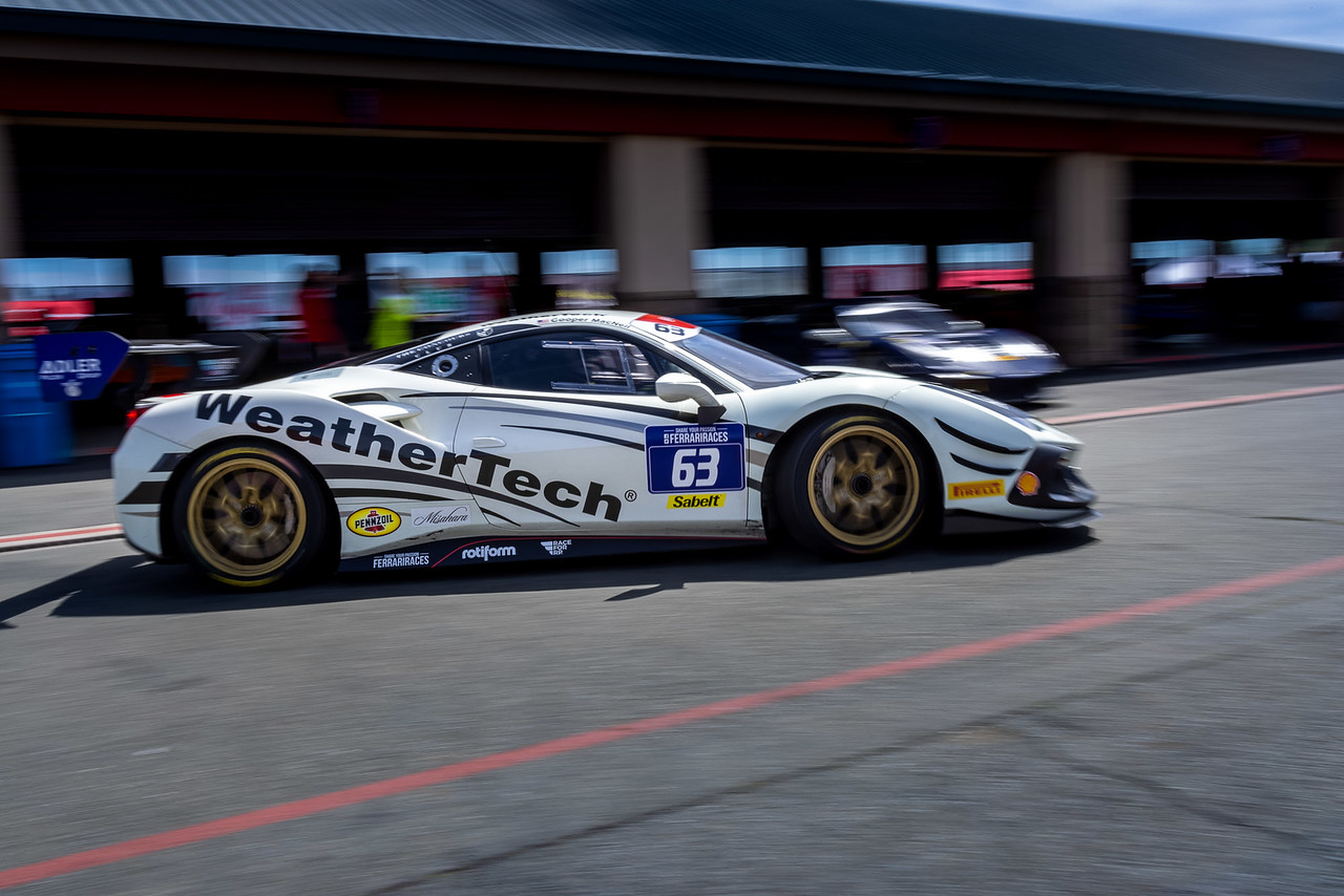 Ferarri pulling out of pit road.