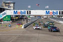 Porsche racing through the starting gate.
