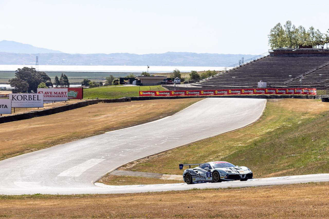Ferrari rounding a turn.