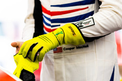 Close up of Cooper putting on gloves.