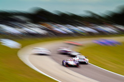 Porsche racing up to a turn.