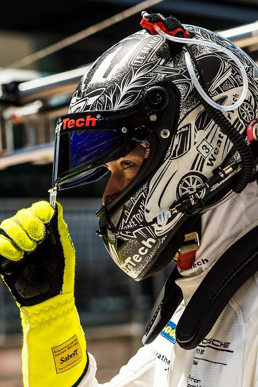 Cooper in racing helmet.
