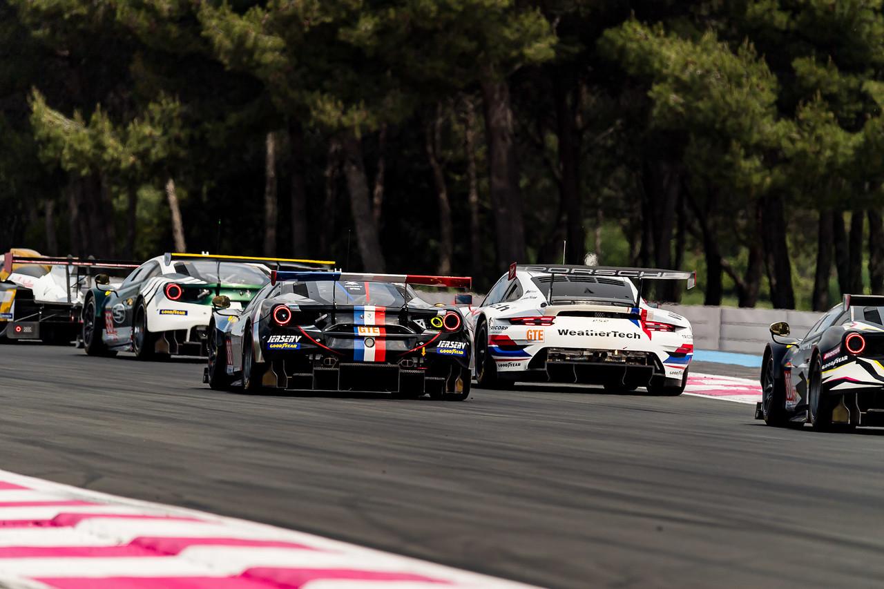 Porsche in traffic.