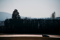 Distance shot of the Ferrari during practice.