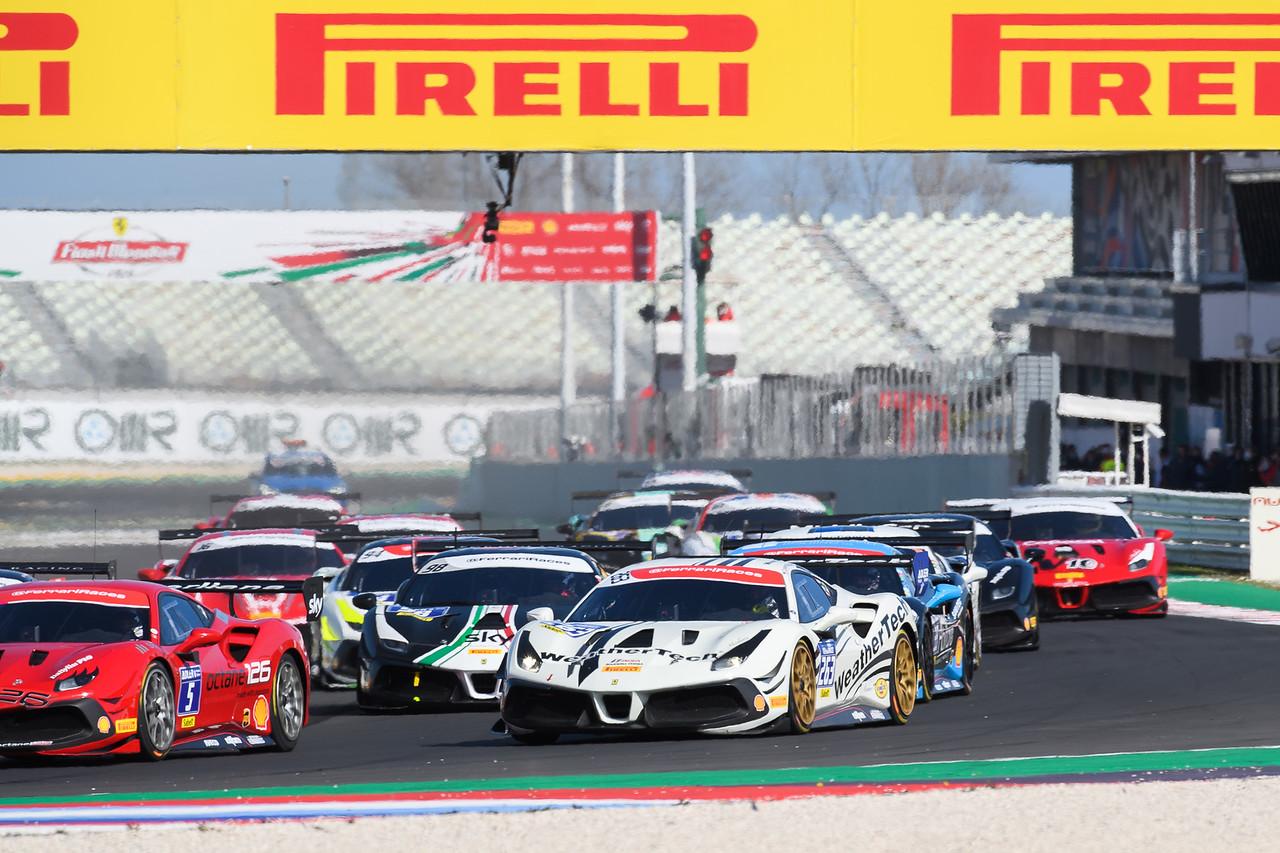 Ferrari in a pack a cars.