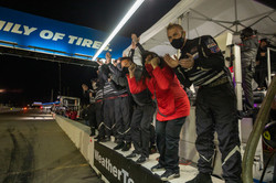 Pit crew cheering the win.