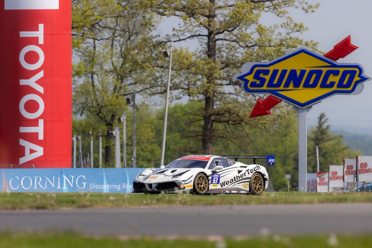 Ferarri racing on track.