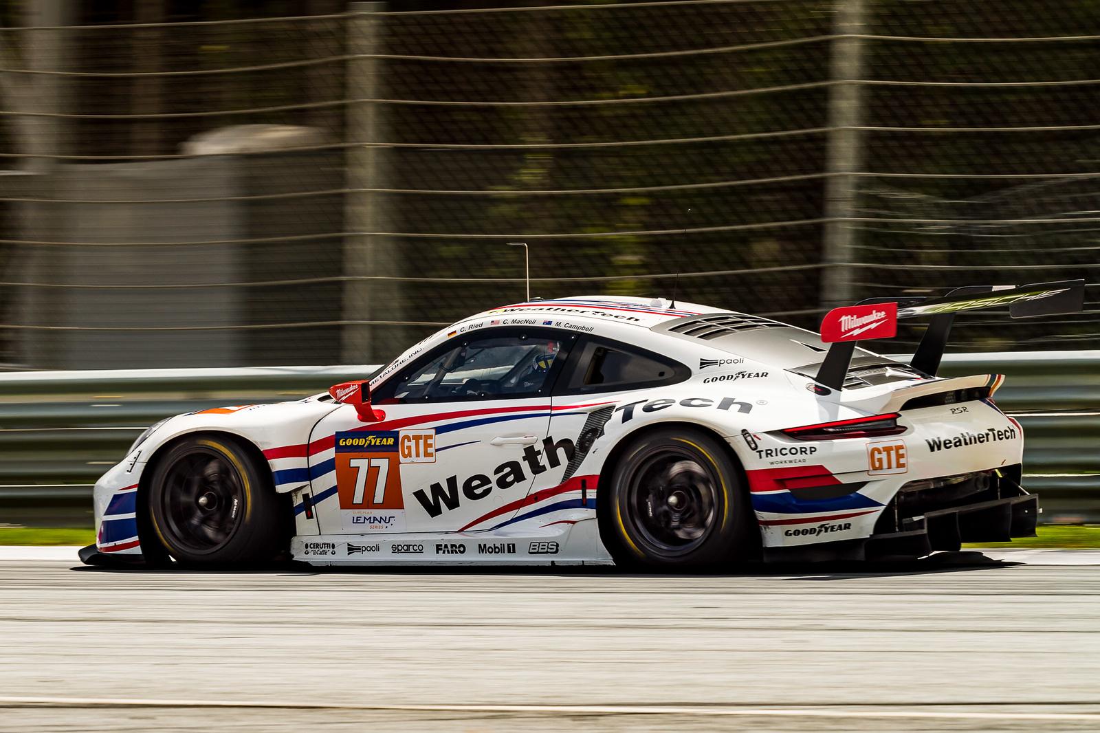 Porsche full throttle on a straight away.