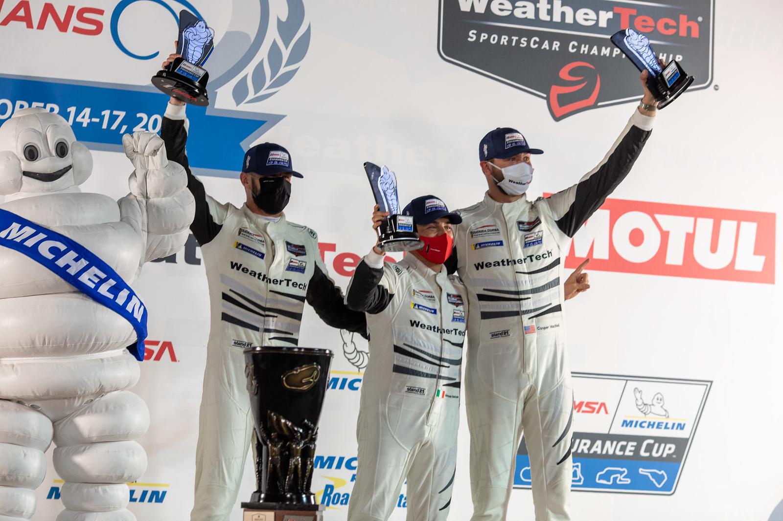 Team on podium.