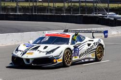 Ferrari parked on track.