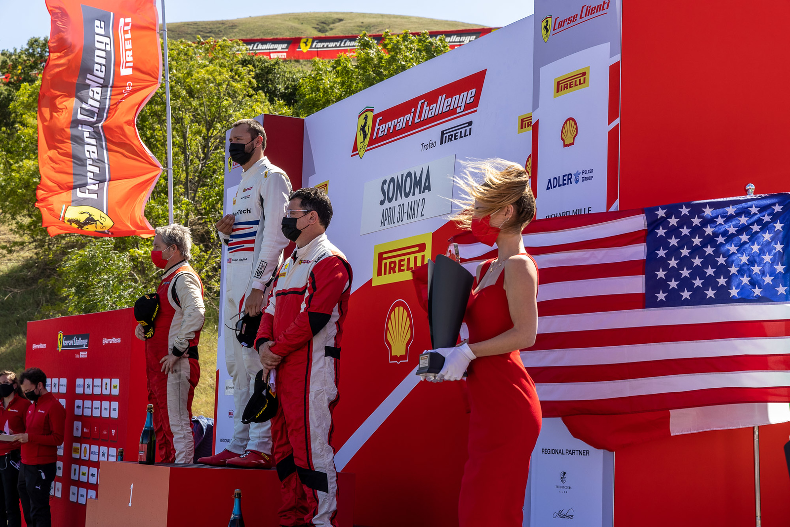 Cooper standing on podium.