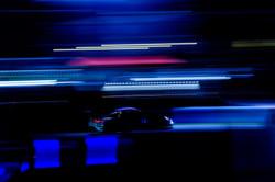 Porsche action shot under the lights.