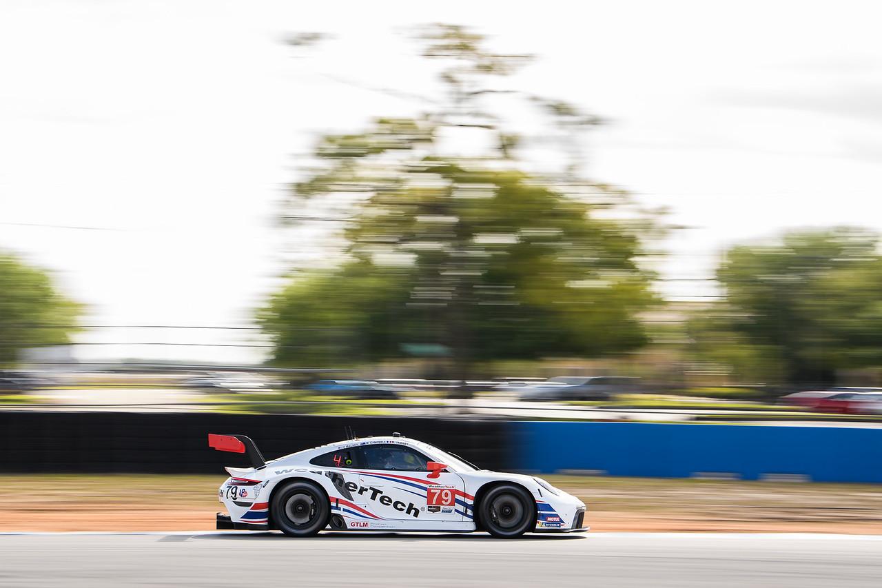Porsche racing on the straight away.