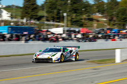 Car racing around track.