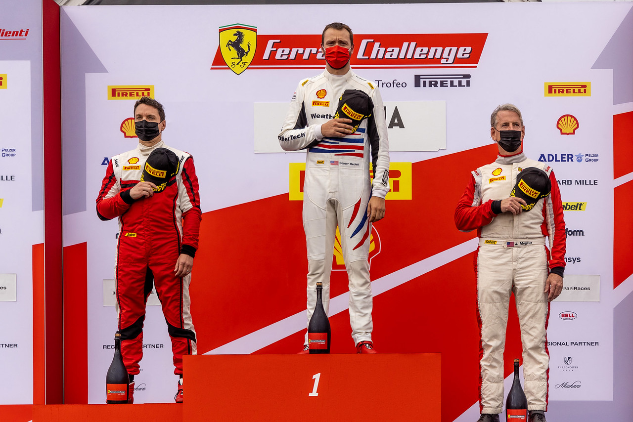 Drivers standing on the podium.