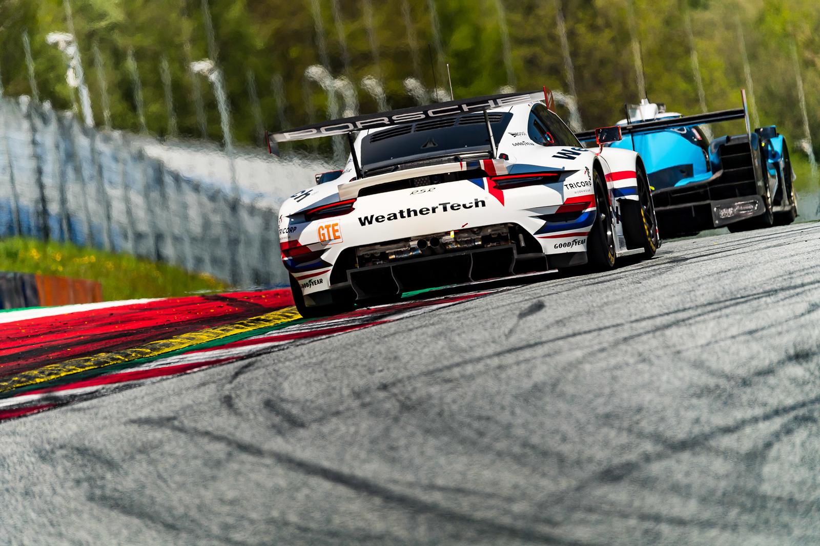 Porsche following the pack.