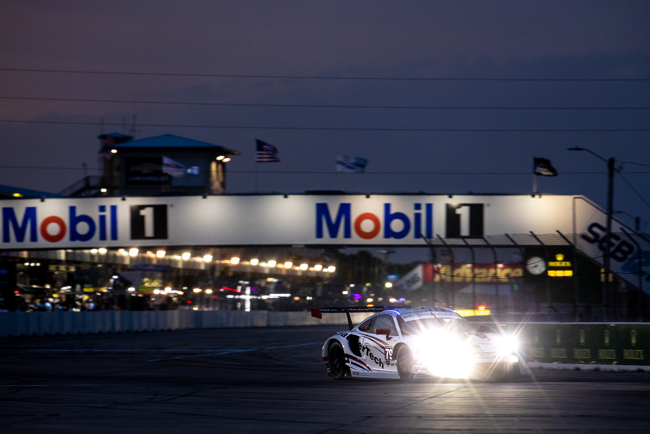 Porsche on the track at night.