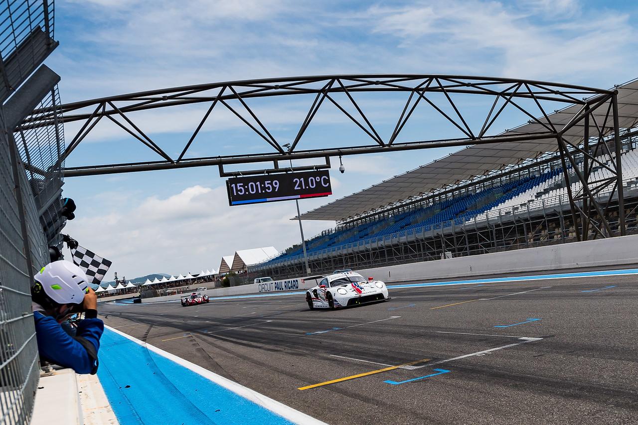 Porsche crossing the finish line.