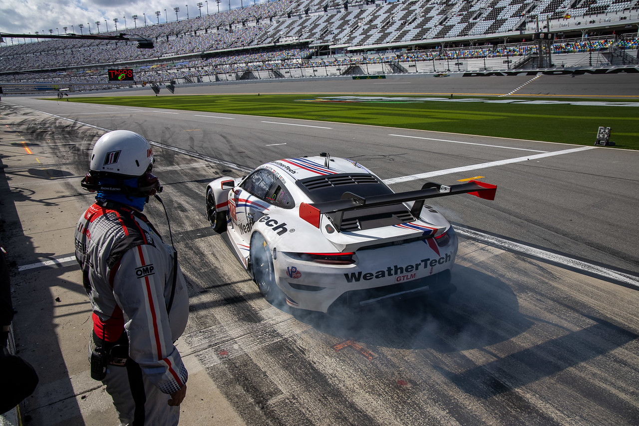 Porsche pulling out of pit road.