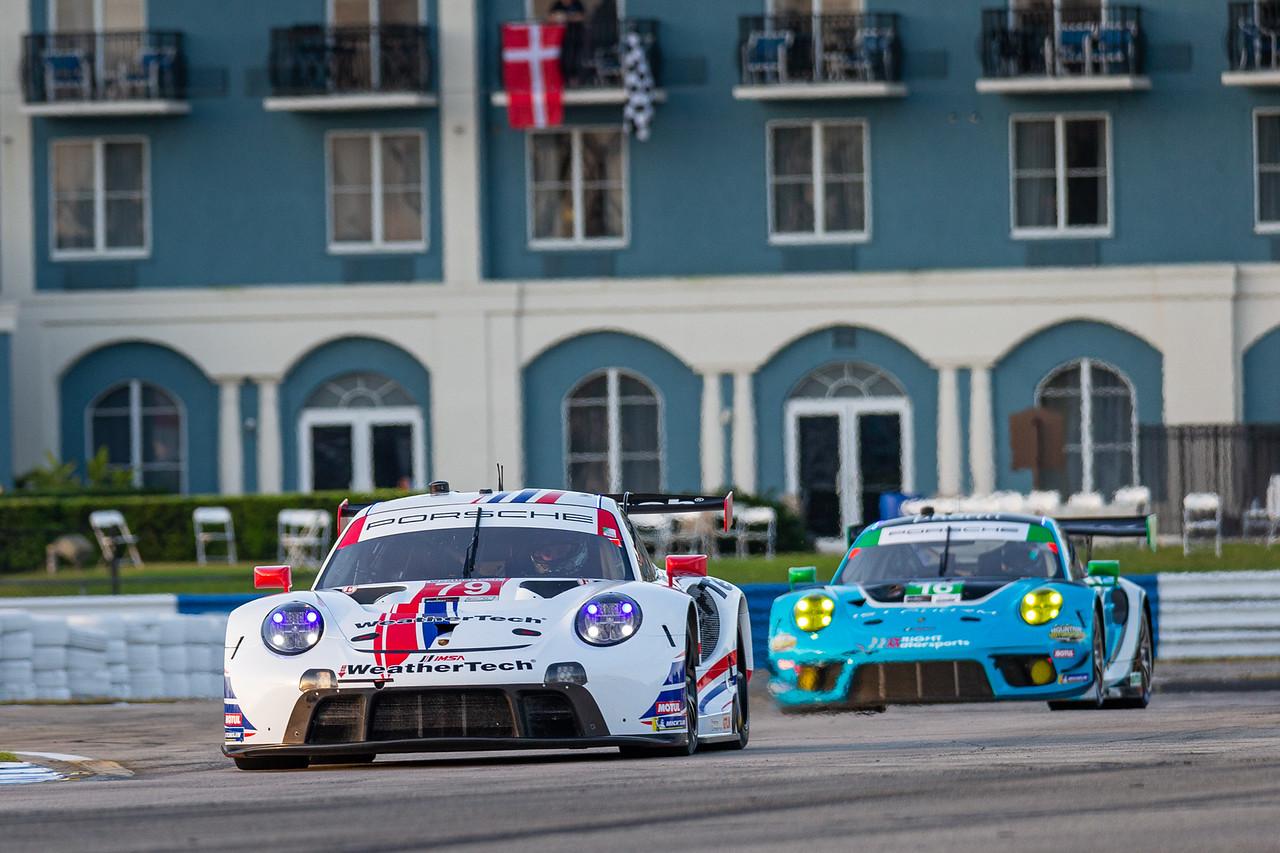 Porsche racing around a short turn.