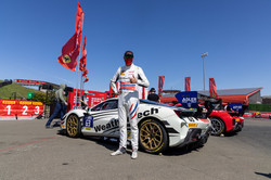 Cooper standing by Ferrari.