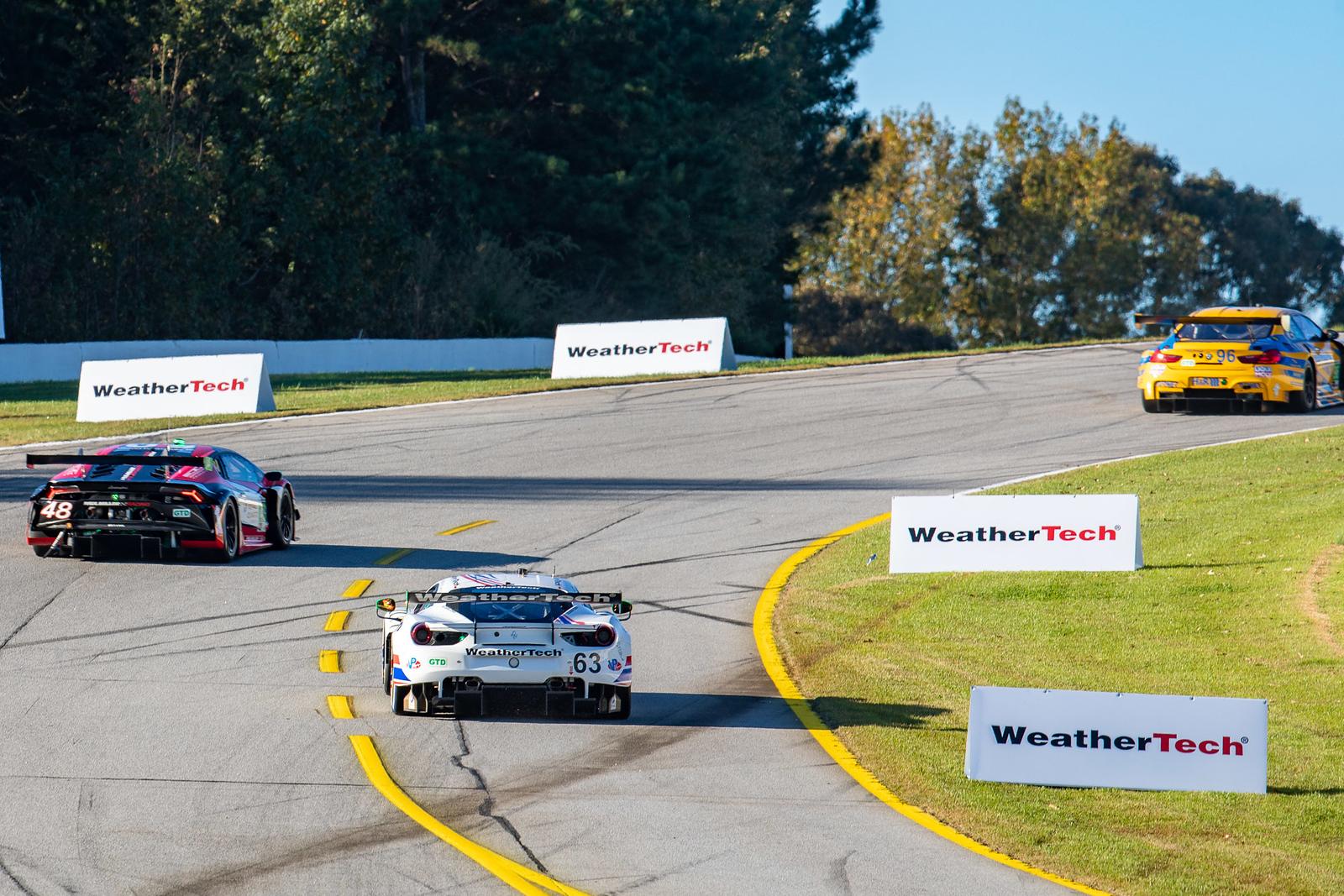 Car racing up a turn.