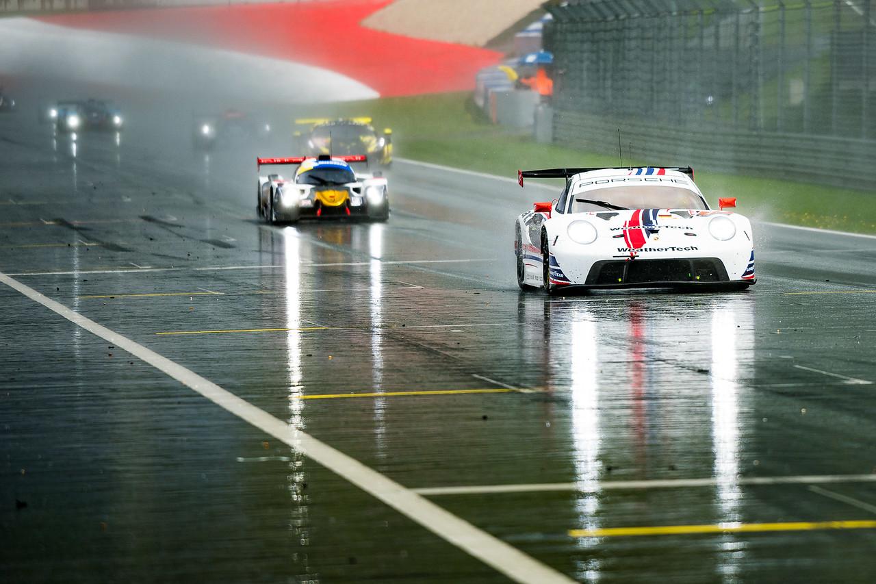 Porsche racing in the rain.