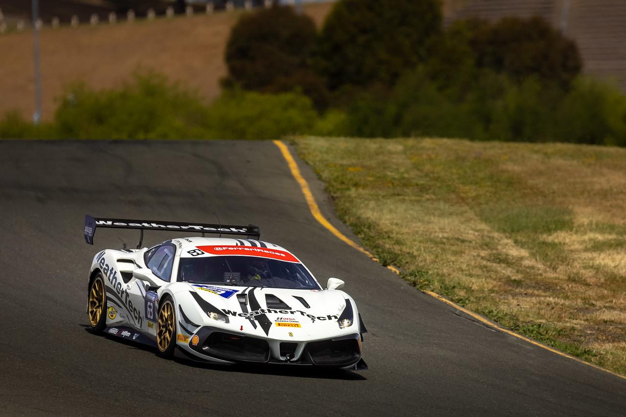 Ferrari racing on the track.