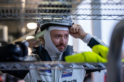 Cooper putting on helmet.
