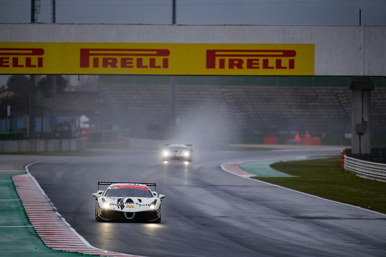 Ferrari rounding a turn in the rain.
