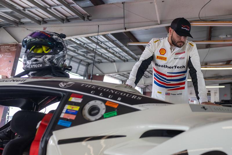 Cooper checking the Ferrari.