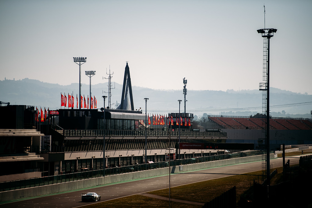 Ferrari driving past the grand stand during practice.