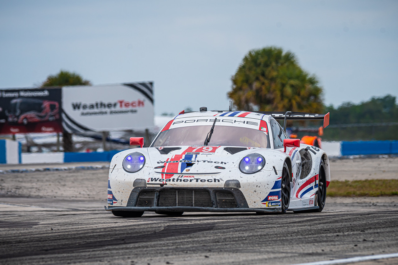 Porsche racing on the track.
