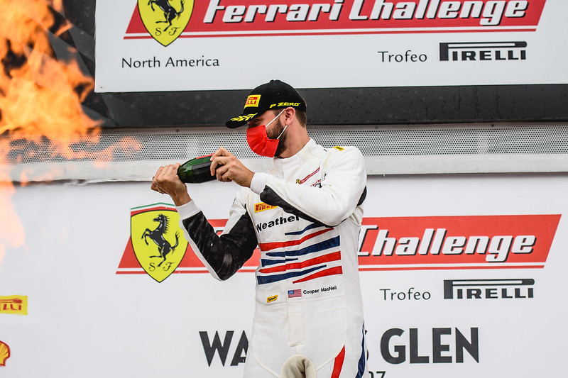 Cooper celebrating a win spraying champagne.