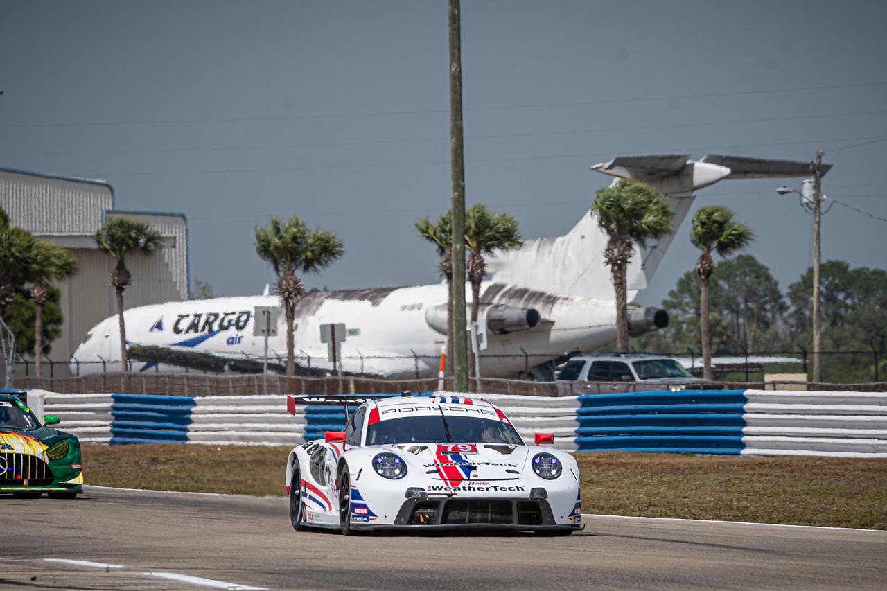 Porsche racing around a turn.