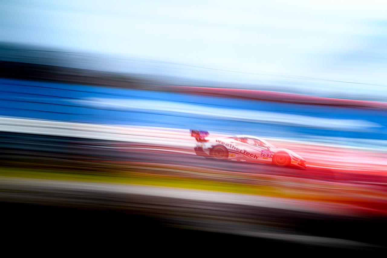 Artistic photo of the Ferrari racing.