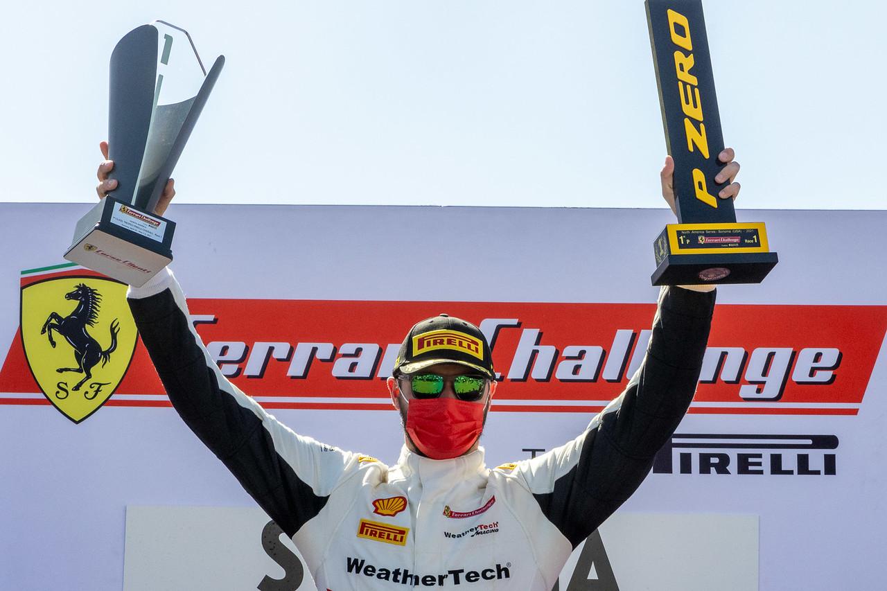 Cooper on podium celebrating win.
