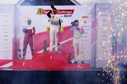 Cooper celebrating on the podium.