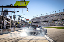 Porsche pulling out of pit road_