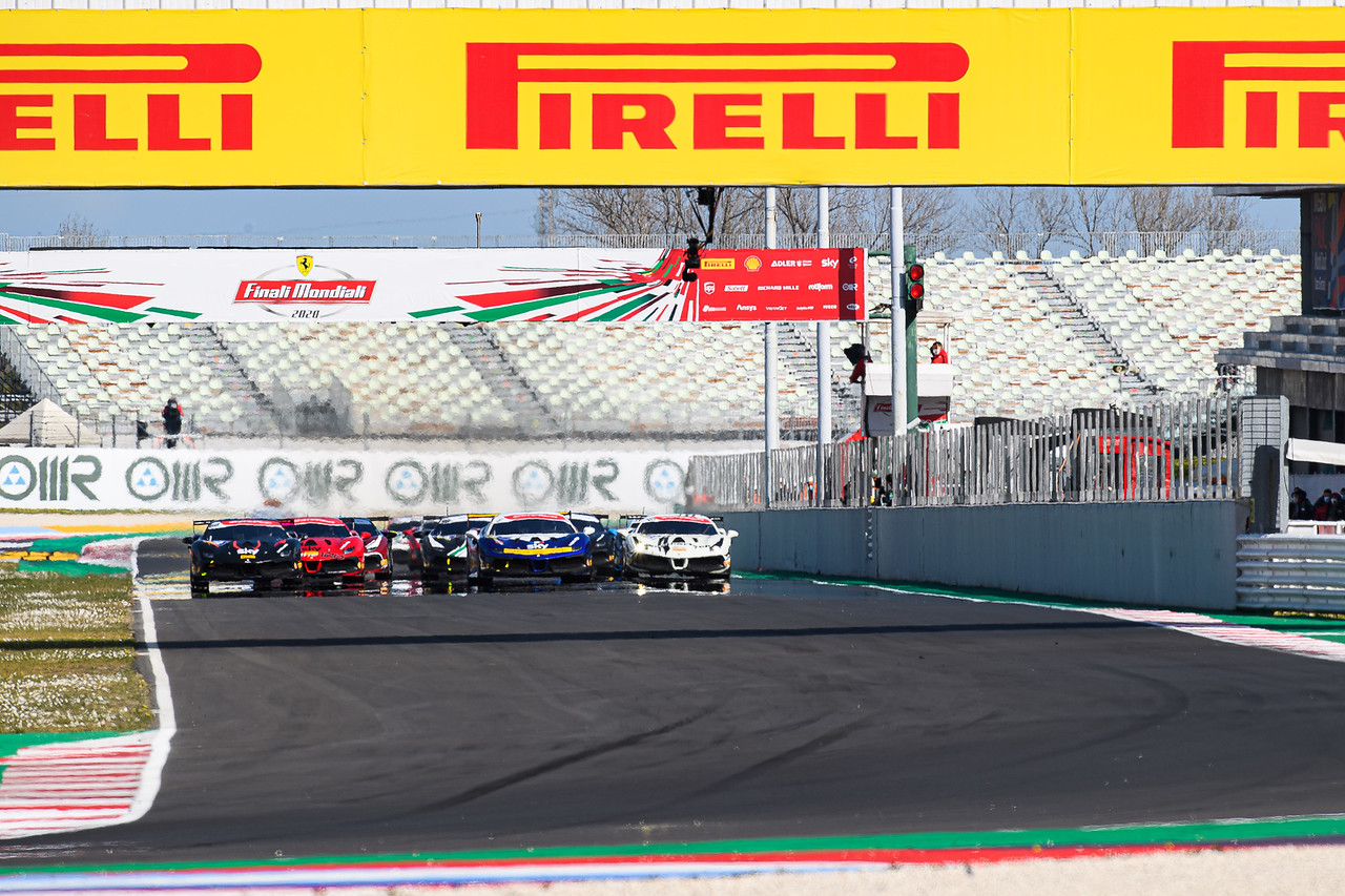 Zoomed out view of Ferrari racing.