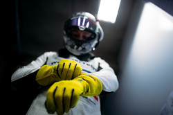 Driver putting gloves on_