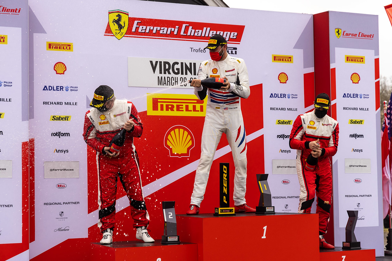 Cooper spraying champagne on the podium.